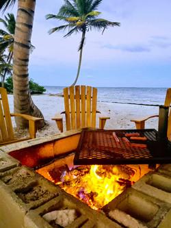 Firepit on the beach at Mangata Villas