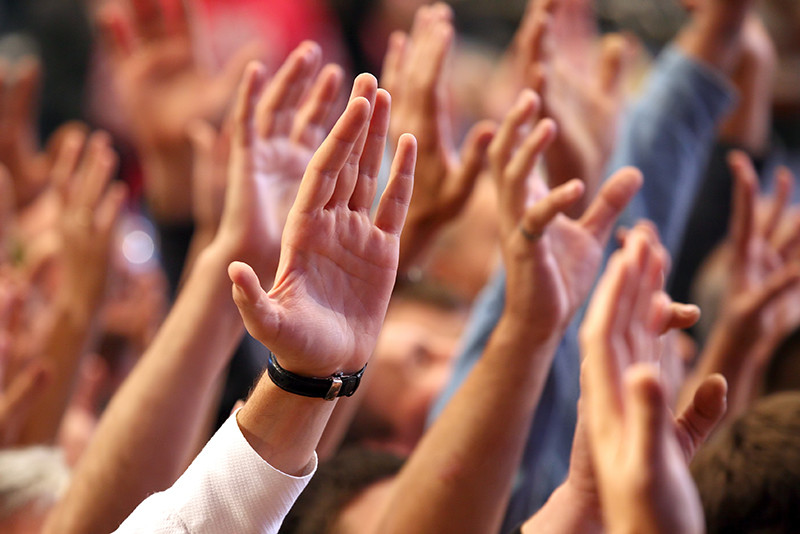 Many People Raising Hands