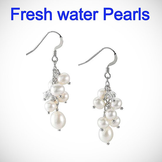 These sterling silver ear wires each features a cluster of round white freshwater