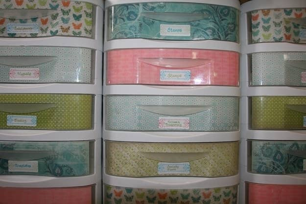 Plastic storage bins are boring and expose all of your junk. Line them with colored paper that matches the rest of your room.Instructions here.