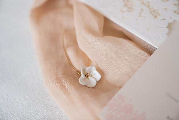 Bespoke stationery close up with hair clip