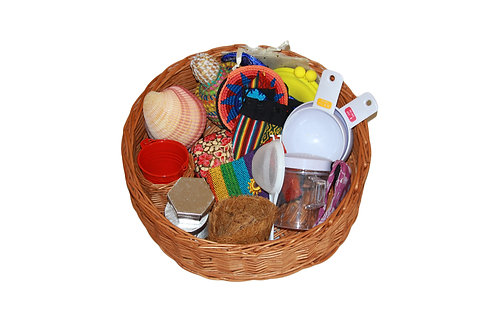 A willow treasure basket filled with an assortment of containers as an early years resource for younger children.