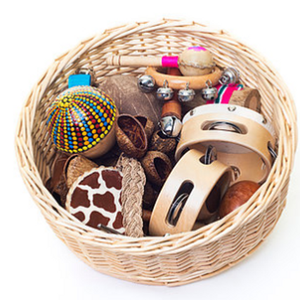 A treasure basket of musical instruments made from natural material, perfect for young children.