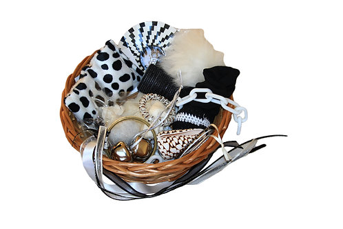 Children's traditional treasure basket exploring the theme of black and white.