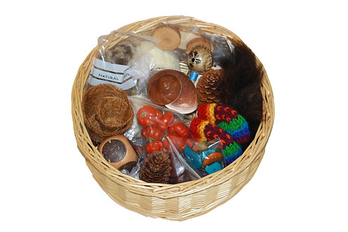 Traditional treasure basket full of natural items for young children to explore