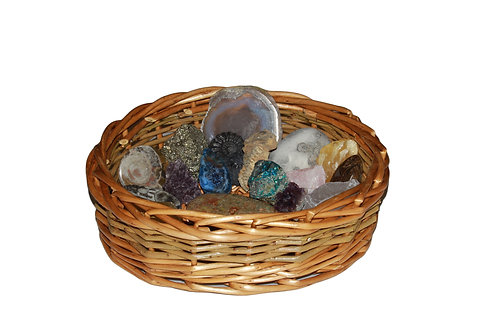 Natural basket containing a number of rocks and fossils as an Early Years resource to stimulate discussion.