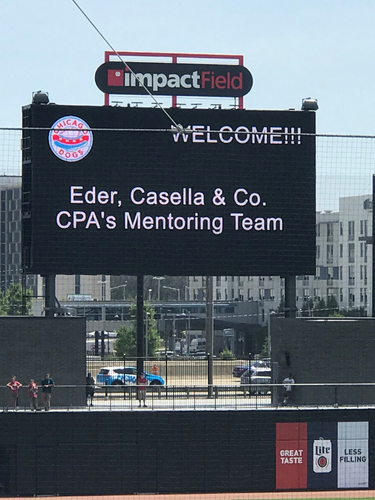 Welcome mentor team sign at Impact field