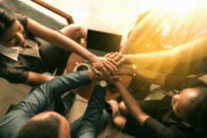 top-view-south-african-business-team-hands-stacked-together-unity-trust-top-view-black-african-busin