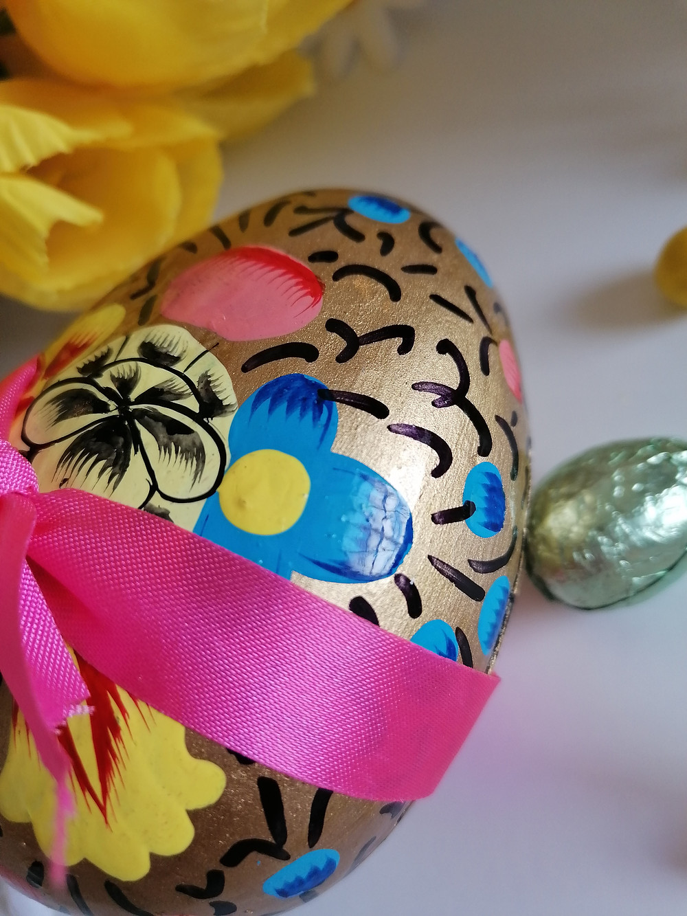Hand painted Booja Booja Easter Egg Shell containing truffles wrapped in a pink bow