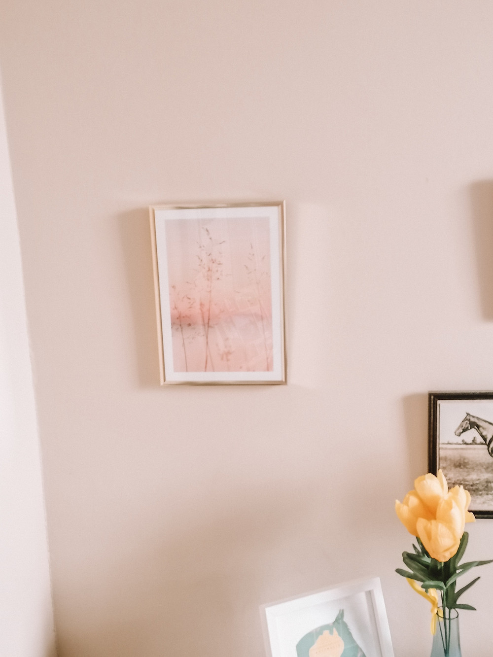 photo shows a sunset picture on a wall in a frame
