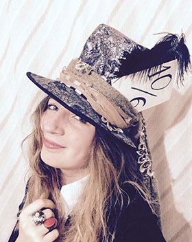 A woman in Mad Hatter outfit