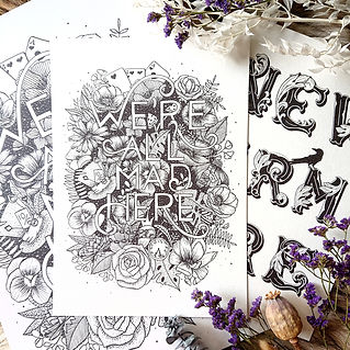 Black and white lettering prints with dried flowers