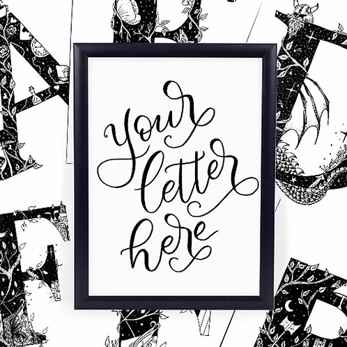 Handwritten text 'your letter here' in a black frame