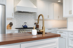 kitchen island with bar sink and wood top