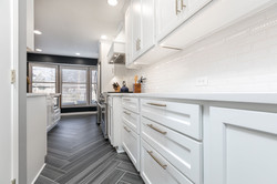 beautiful cabinetry and floor tile