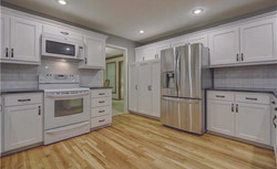 clean white cabinetry in kitchen remodel
