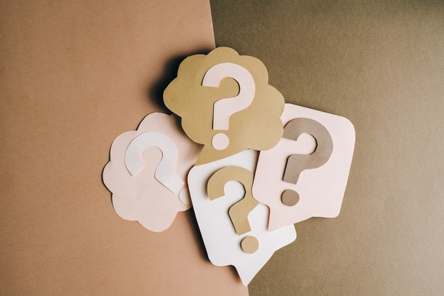Pink and brown paper question marks