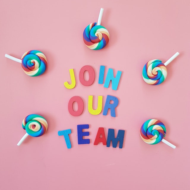 'Join our team' letters on pink background