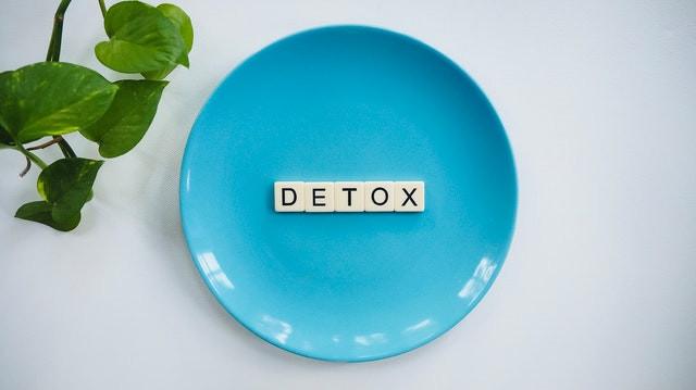 Tiles spelling 'Detox' on blue plate