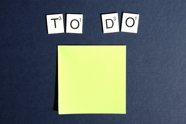 Letter tiles spelling 'To Do' above yellow post-it note