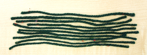 Strands of yarn laid side by side