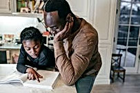 black man homeschooling son.jpeg