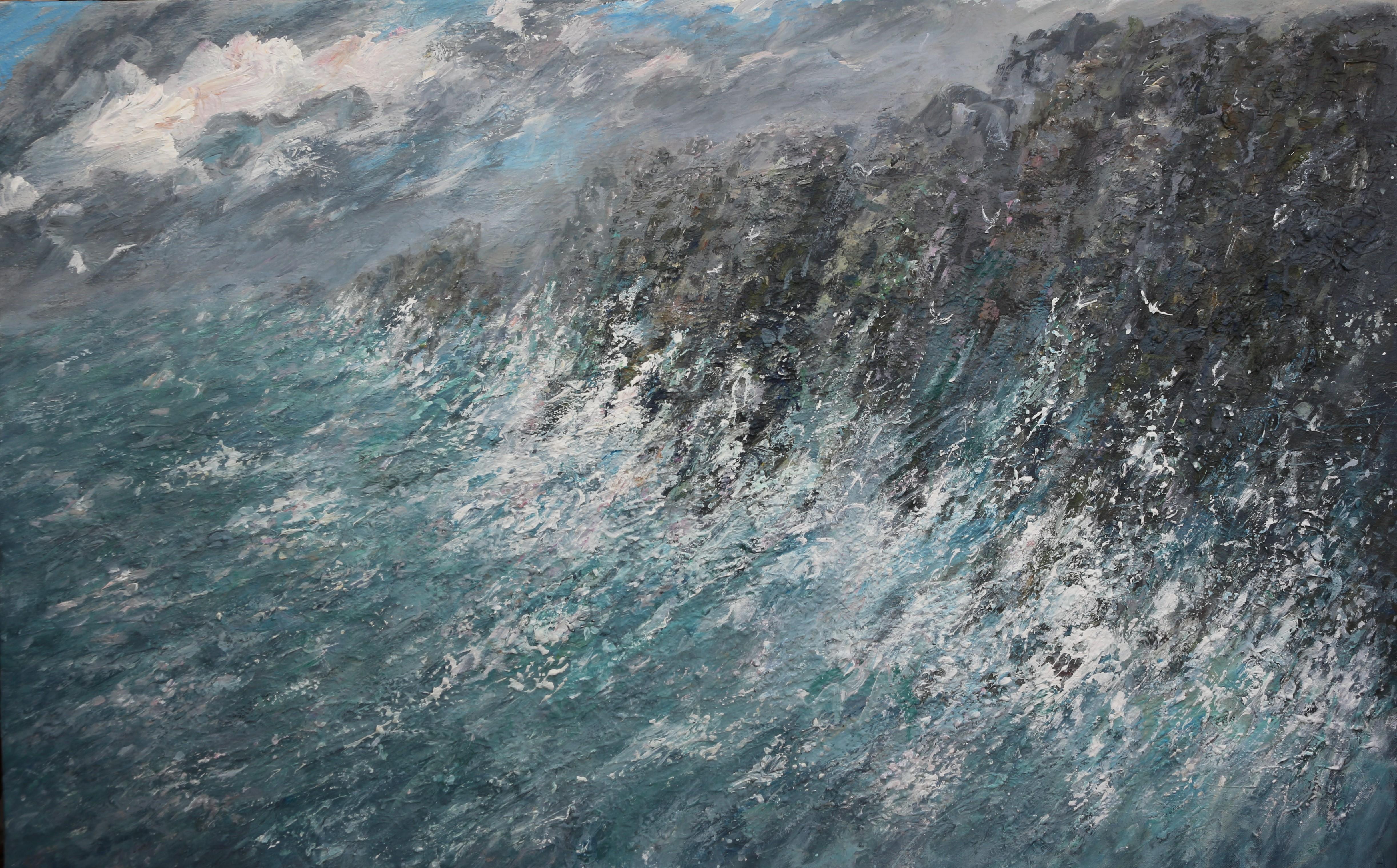 Billowing clouds crashing waves