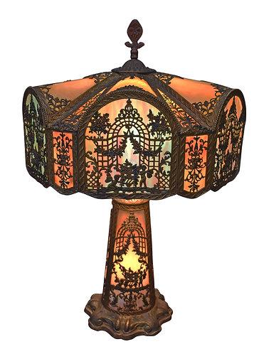 Best Example of a Bent Panel Glass Lamp w/ Cherub Metal Overlay
