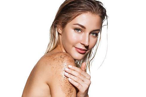 Blond hair woman with scrub for body care on her shoulder. Happy smiling woman portrait isolated on