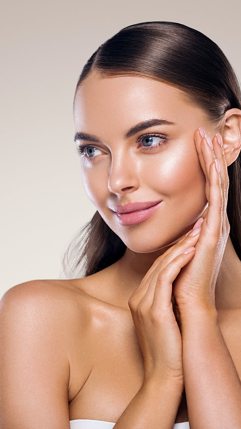 Beauty face woman healthy tanned skin manicure nails hand touching skin clean spa young beautiful mo