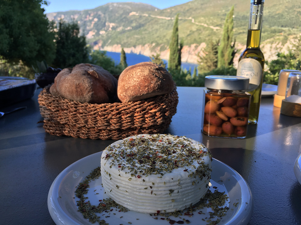 Local food, cheese, bread, olives at the eco chic Levendis Estate