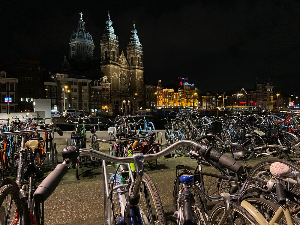 Bikes parked up outside Amsterdam Centraal railway station