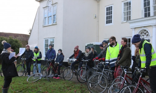 Group of cyclists at start of bike trail quiz.