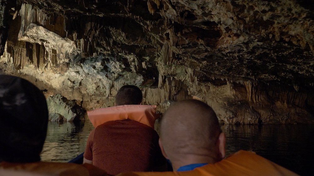 Boat tour through the Dinos Caves