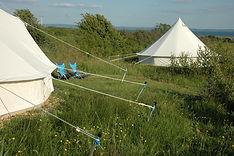bell-tents-river.jpg