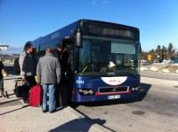Passenger boarding the navette bus shuttle outside Avignon TGV station.