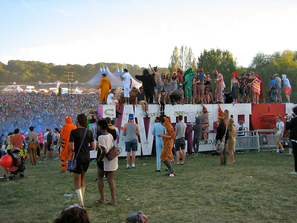 Party revellers in the evening sunshine at Bestival