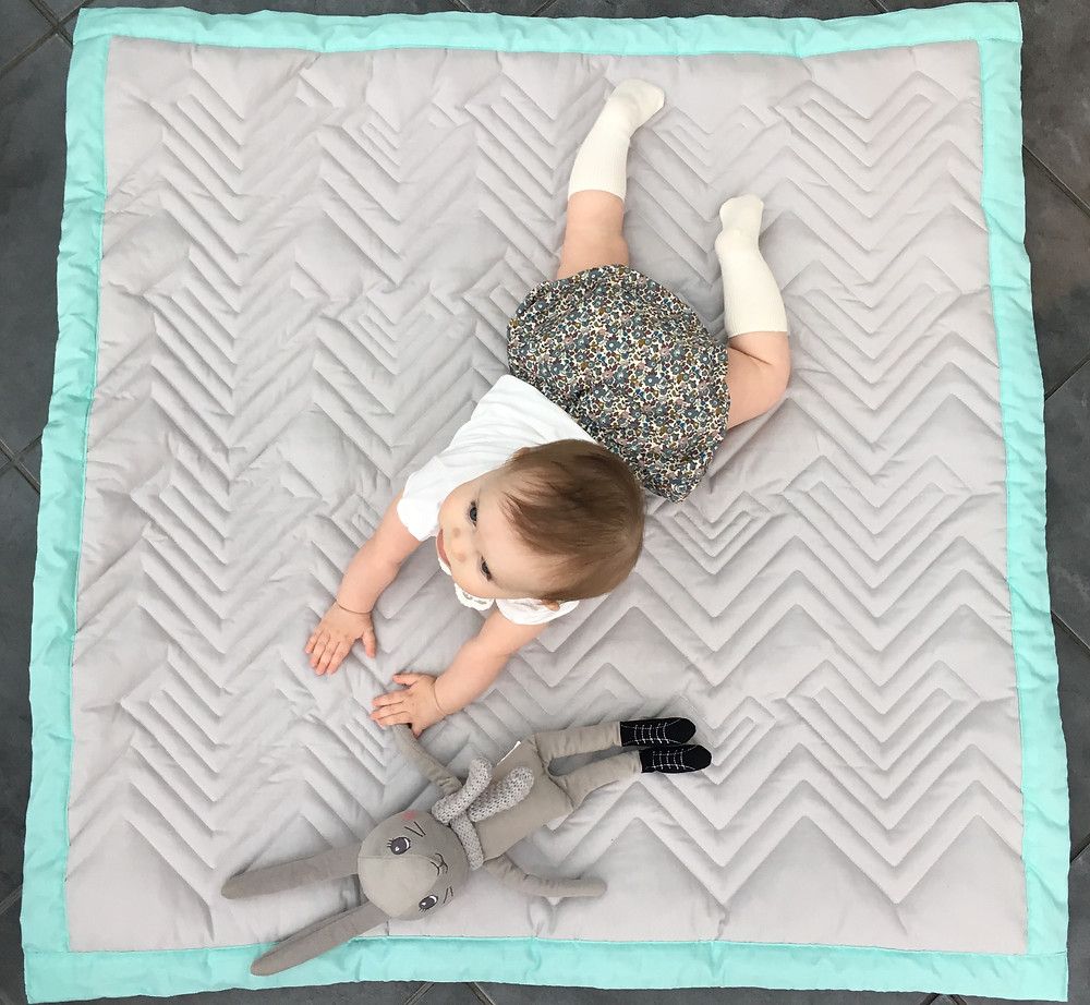 Mint green and grey playmats