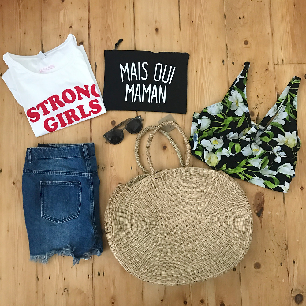 Flatlay pic of summer clothes including asos maternity tankini