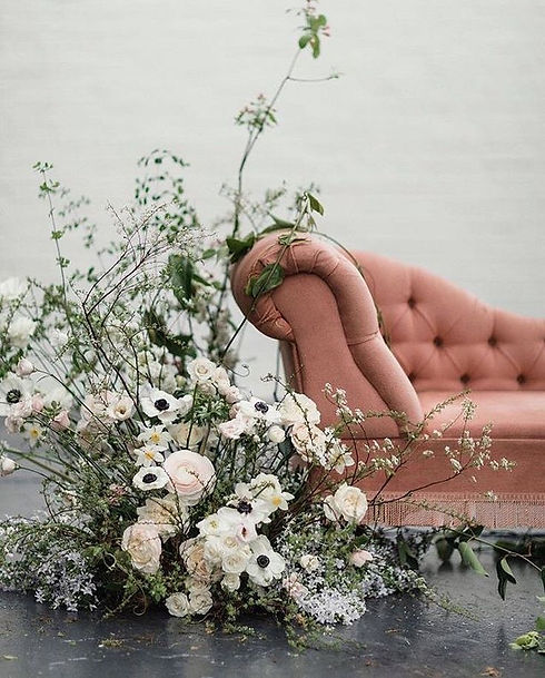 asymmetric loose and organic floral installation wedding reception drinks areas- lounge se