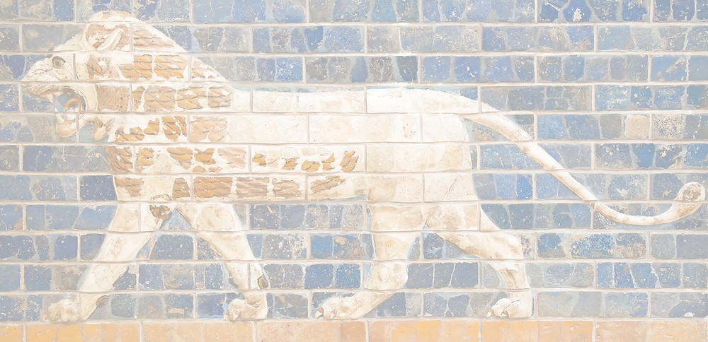 Image of a brick relief showing a yellow lion on a blue background