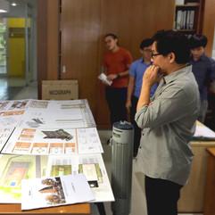 Director reviewing presentation panels
