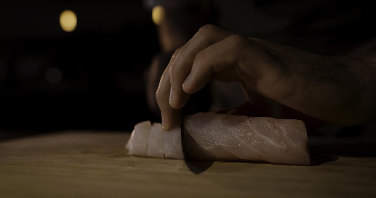 Chef Lucas Parkinson prepares dish with sustainable fishing ingredients