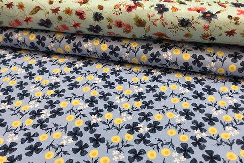 Baumwolljersey, Blumenmuster auf einfarbigem Hintergrund