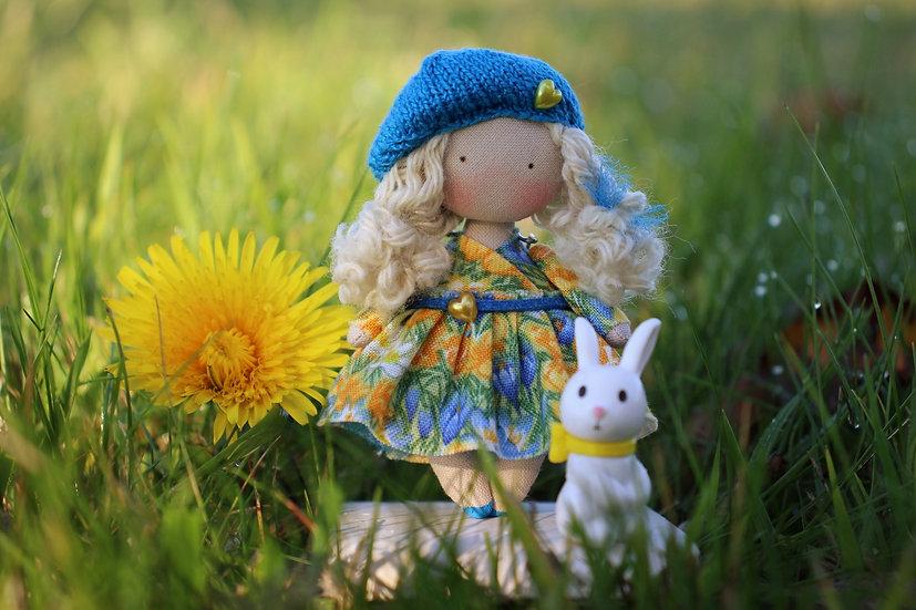 Miniature handmade cloth art doll in flower dress