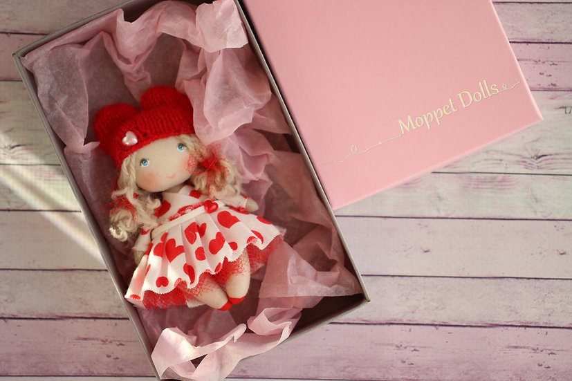 Little handmade cloth doll for dollhouse in packaging for travel