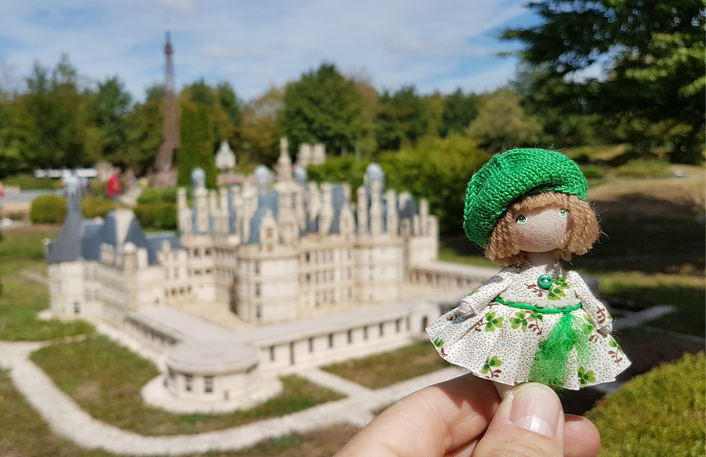 Miniature fabric doll in front of the royal castle of Chambord