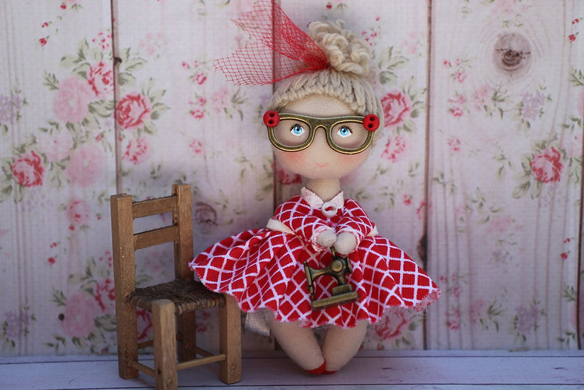 Miniature cloth doll with a sewing machine