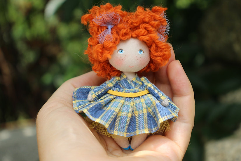 Little redhead cloth art doll with freckles
