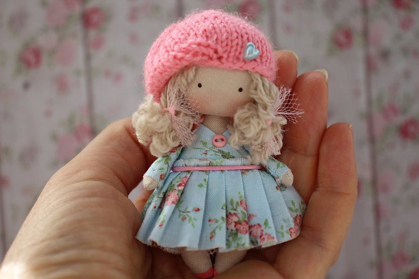 Miniature collectible rag doll in pink beret